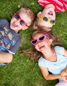 Laughing children relaxing during summer day